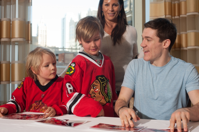 sports celebrity photo of young fans meet and greet with chicago blackhawks andrew shaw.