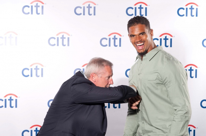 Chicago Bears Cory Wootton has fun with fan at Citi Bank Bulls Bears meet and greet, onsite printing provided by fab photo.