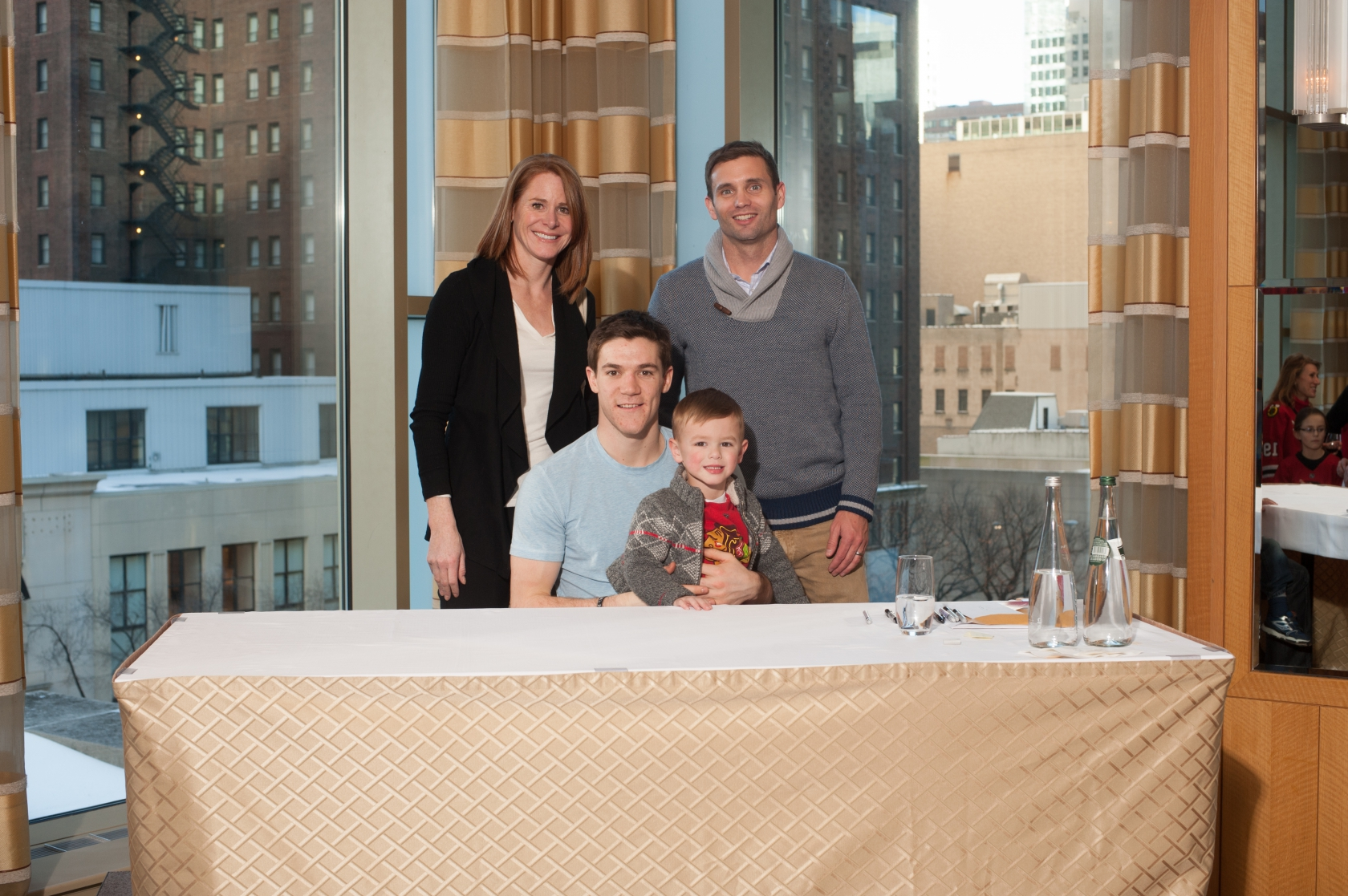 Corporate event photography chicago corporate event photographer sports celebrity photo of family meet and greet with chicago blackhawks andrew shaw kristyandbryce Image collections