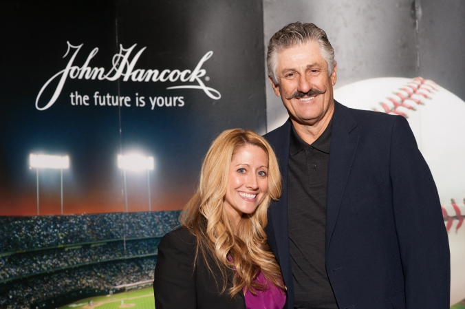 Hall of Fame pitcher Rollie Fingers poses with a lovely fan at the  John Hancock photobooth activity at the morning star investment conference.
