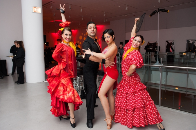 Flamenco dancers strike a pose before they perform at Grant Thorntons annual holiday party