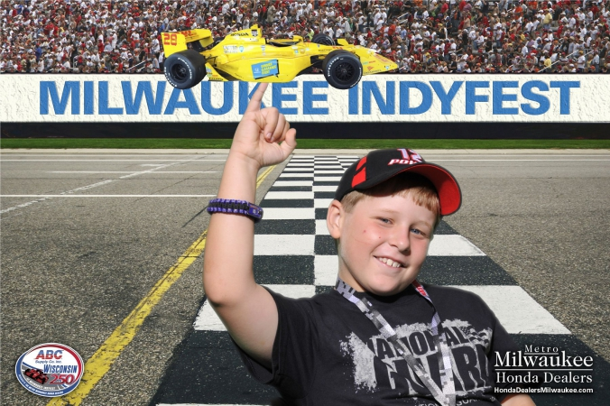 proud kid balances formula car on little finger, green screen photography magic by fab photo chicago, milwaukee indyfest