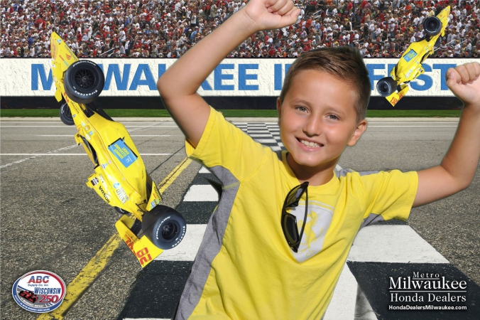 yellow shirt kid poses with flying formula cars in fabphotochicago green screen photography, milwaukee indyfest