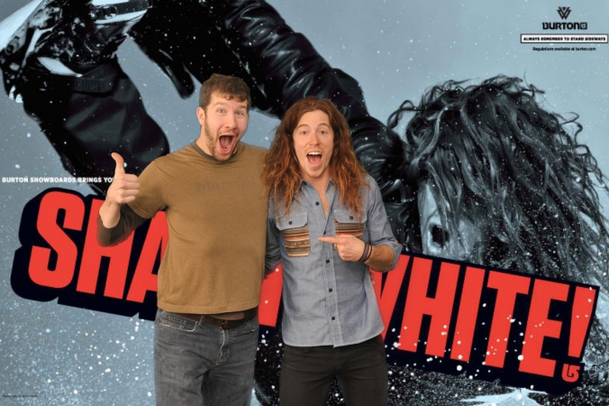 stoked fan poses with celebrity superstar shaun white at burton snowboard green screen photo activity