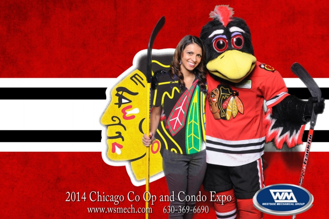 fan poses with tommy hawk, gets logo branded photo print onsite, expo, navy pier, chicago