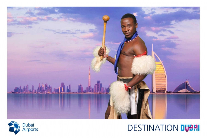 swasiland warrior with burj al arab green screen photo becomes logo branded postcard, world routes annual conference