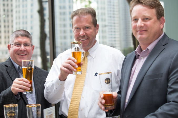 tres hombres enjoy guinness at beer tasting event, downtown chicago